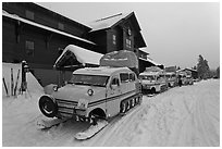 Snow busses in front of Old Faithful Snow Lodge. Yellowstone National Park, Wyoming, USA. (black and white)