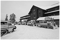 Winter Snowcoaches in front of Old Faithful Snow Lodge. Yellowstone National Park, Wyoming, USA. (black and white)