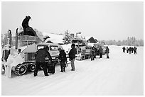 Bombardier snow busses being unloaded at Flagg Ranch. Yellowstone National Park, Wyoming, USA. (black and white)