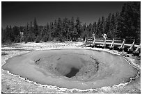Morning Glory Pool with visitors. Yellowstone National Park ( black and white)