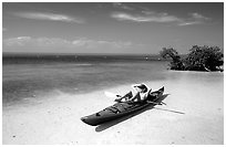 Kayaker relaxing on Elliott Key. Biscayne National Park, Florida, USA. (black and white)