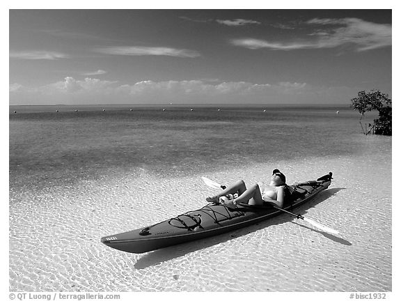 Woman reclining in kayak on shallow waters,  Elliott Key. Biscayne National Park (black and white)