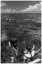 Snorkelers entering water. Biscayne National Park ( black and white)