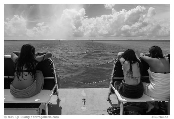 Women sunning themselves on snorkeling boat. Biscayne National Park (black and white)