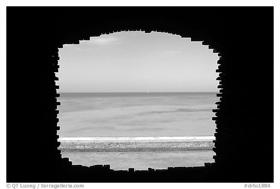Turquoise waters framed by a cannon embrasure in Fort Jefferson. Dry Tortugas National Park (black and white)
