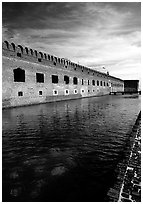 Fort Jefferson moat and thick brick walls. Dry Tortugas National Park, Florida, USA. (black and white)