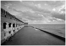 Fort Jefferson wall, moat and seawall, late afternoon light. Dry Tortugas National Park, Florida, USA. (black and white)