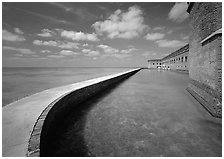 Seawall and moat on a calm sunny day, Fort Jefferson. Dry Tortugas  National Park ( black and white)