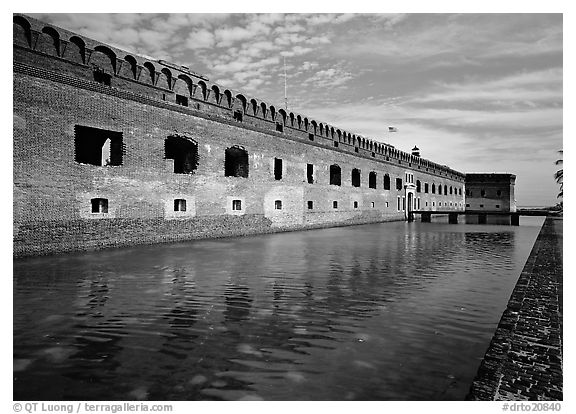 Fort Jefferson moat, walls and lighthouse. Dry Tortugas National Park (black and white)