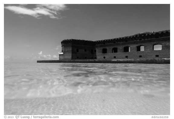 Split view of Fort Jefferson and clear sandy bottom. Dry Tortugas National Park (black and white)