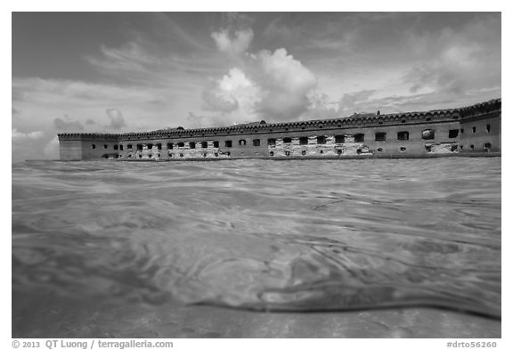 Split view of Fort Jefferson and water with fish. Dry Tortugas National Park (black and white)