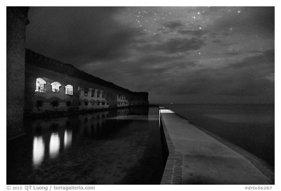 Fort Jefferson, moat, and ocean at night. Dry Tortugas National Park (black and white)