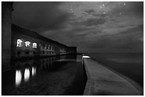 Fort Jefferson, moat, and ocean at night. Dry Tortugas National Park, Florida, USA. (black and white)