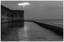 Moat, fort, bright cloud at dawn. Dry Tortugas National Park, Florida, USA. (black and white)