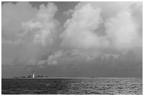 Loggerhead key and lighthouse under tropical clouds. Dry Tortugas National Park ( black and white)