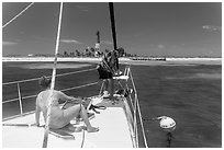 Sailors hooking mooring buoy at Loggerhead Key. Dry Tortugas National Park, Florida, USA. (black and white)