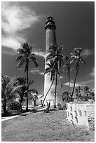 Palm trees, keeper house, and Loggerhead Light. Dry Tortugas National Park, Florida, USA. (black and white)
