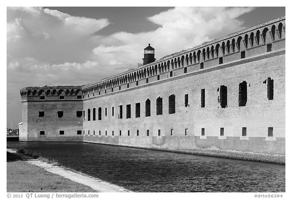 Moat, wall, and Harbor Light. Dry Tortugas National Park (black and white)