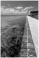 Seawall and coral reefs. Dry Tortugas National Park, Florida, USA. (black and white)