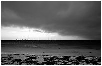 Approaching storm over Yachts at Tortugas anchorage. Dry Tortugas National Park, Florida, USA. (black and white)