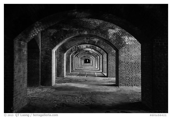 Gallery illuminated by last light inside Fort Jefferson. Dry Tortugas National Park (black and white)