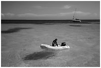 Dinghy and sailbaot in transparent waters, Loggerhead Key. Dry Tortugas National Park, Florida, USA. (black and white)