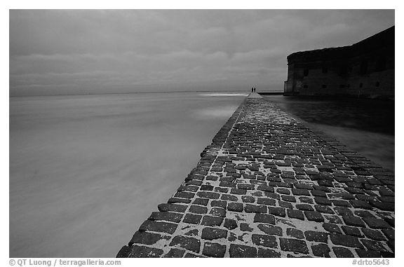 Brick seawall at dusk during a storm. Dry Tortugas National Park (black and white)