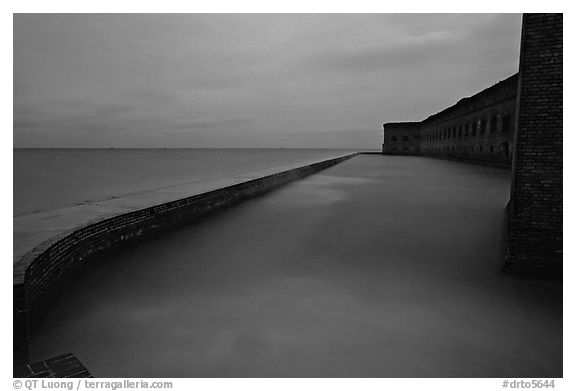Seawall at dusk during  storm. Dry Tortugas National Park (black and white)