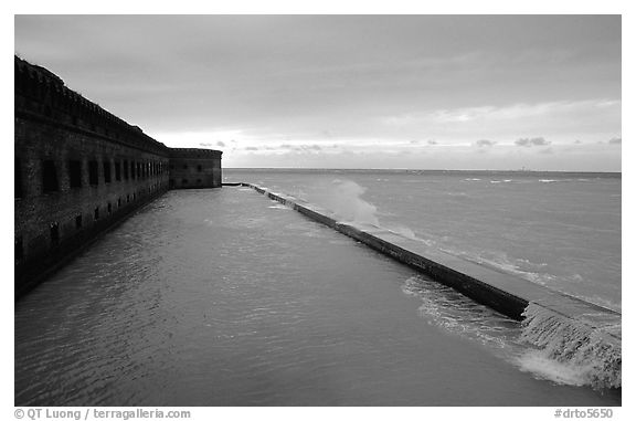 Seawall and moat with waves on stormy day. Dry Tortugas National Park (black and white)