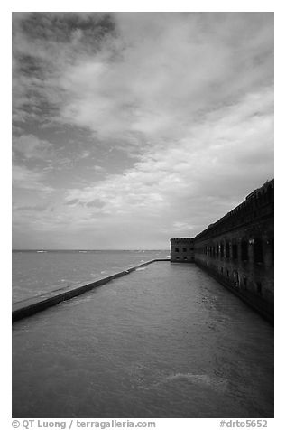 Sky, seawall and moat on windy day. Dry Tortugas National Park (black and white)