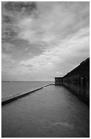 Sky, seawall and moat on windy day. Dry Tortugas National Park, Florida, USA. (black and white)