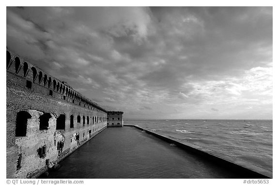 Fort Jefferson seawall and moat, late afternoon. Dry Tortugas National Park (black and white)