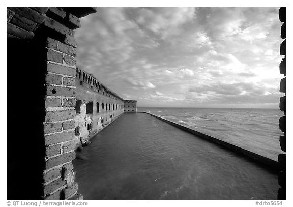 Fort Jefferson wall and moat, framed by cannon window. Dry Tortugas National Park (black and white)