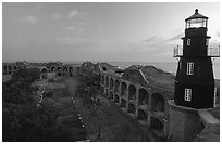 Fort Jefferson lighthouse and inner courtyard, dawn. Dry Tortugas National Park, Florida, USA. (black and white)