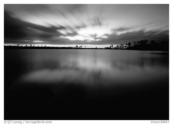 Dusk at Pine Glades Lake, with blured water and clouds. Everglades  National Park (black and white)