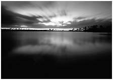 Dusk at Pine Glades Lake, with blured water and clouds. Everglades National Park, Florida, USA. (black and white)