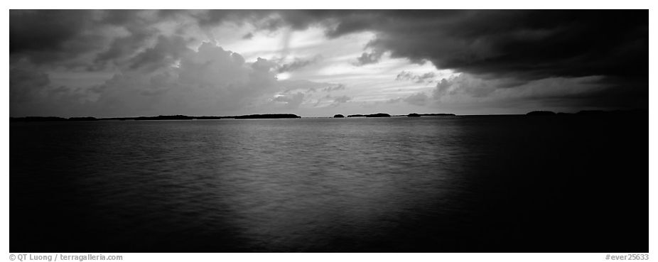 Stormy sunset over bay with low islets in background. Everglades National Park (black and white)