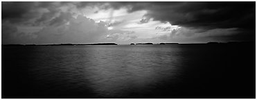 Stormy sunset over bay with low islets in background. Everglades National Park (Panoramic black and white)