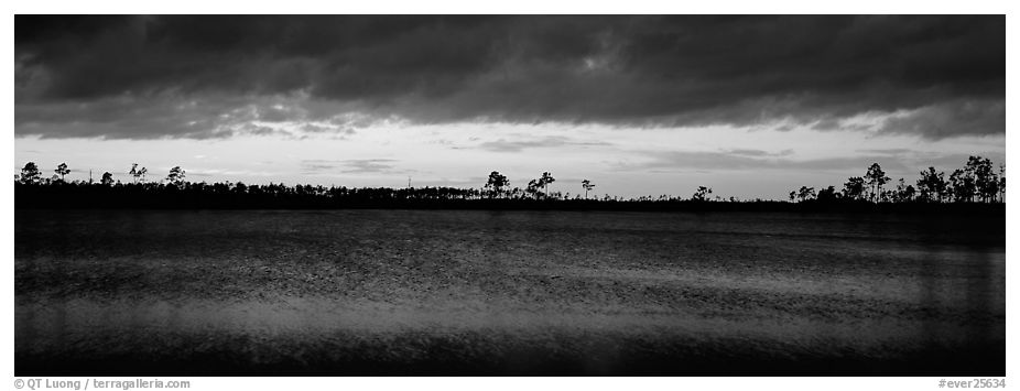 Sunset over lake with dark clouds. Everglades National Park (black and white)