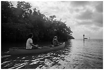Couple canoeing towards Florida Bay. Everglades National Park ( black and white)
