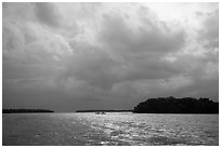Storm clouds and canoe, Florida Bay. Everglades National Park ( black and white)