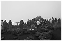 Visitors waiting for sunrise. Haleakala National Park, Hawaii, USA. (black and white)