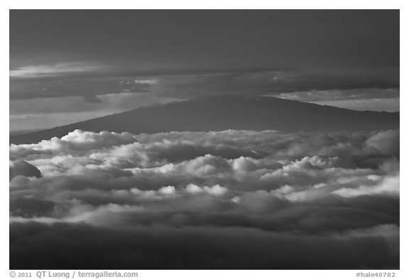 Mauna Kea between clouds, seen from Halekala summit. Haleakala National Park, Hawaii, USA.