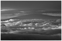 Mauna Kea between clouds, seen from Halekala summit. Haleakala National Park, Hawaii, USA. (black and white)
