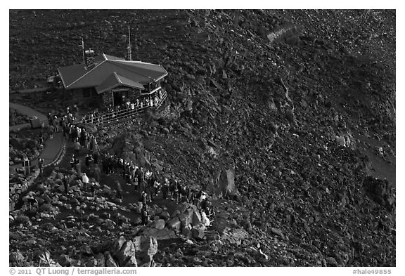 Visitor center and sunrise watchers at dawn. Haleakala National Park (black and white)