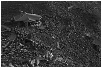 Visitor center and sunrise watchers at dawn. Haleakala National Park, Hawaii, USA. (black and white)