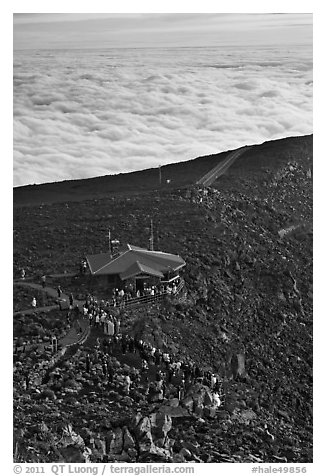 People gather to watch sunrise above sea of clouds. Haleakala National Park (black and white)