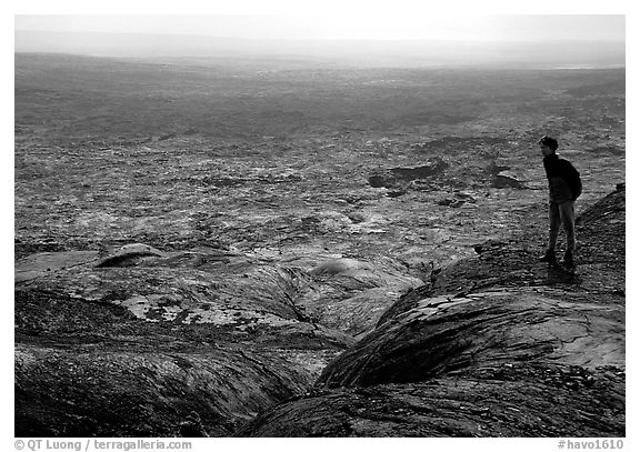 Hiker on top of Mauna Ulu crater. Hawaii Volcanoes National Park (black and white)