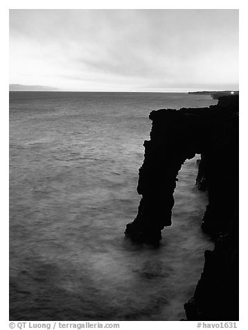 Holei sea arch at sunset. Hawaii Volcanoes National Park (black and white)