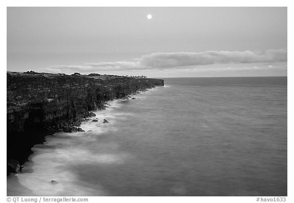 Holei Pali cliffs and moon at dusk. Hawaii Volcanoes National Park (black and white)